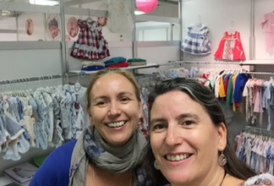 The sisters at a trade show, showing the wonderful clothing from Spain!