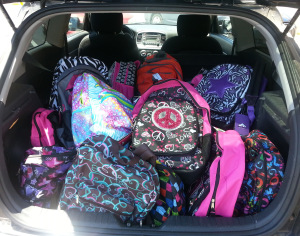 A trunk filled with backpacks from Operation Backpack 2013.
