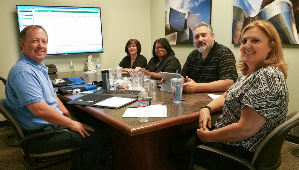From the left, clockwise: Scott Bentley, Auburn Union School District, Chief Business Officer, Angela DeGraaf, Placer COE, IT Support Specialist III, Roveta Waters, Placer COE IT Support Specialist III, Joel Toste, Placer COE Senior Director Integrated Fiscal Services and Terri Hammond, Escape System Trainer
