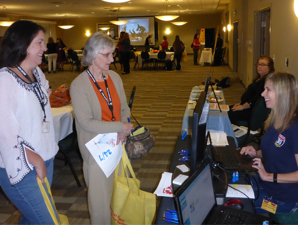 Jennifer Escamilla, Escape Product Manager, talks with  Terri Vaskis, Account Technician I in charge of External Payroll and co-STRS reporter, and   Sheila Walker, Account/Retirement Technician,  from Tehama CDOE.