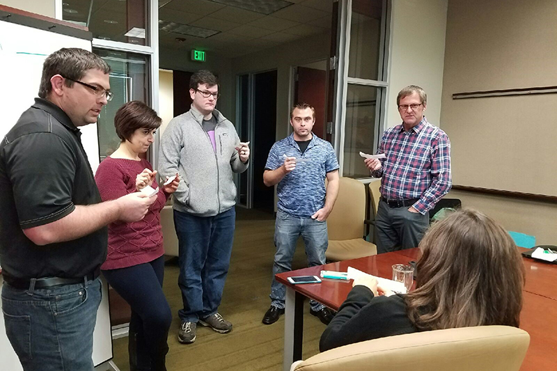 JJ John Johnston, Software Support Analyst; Arin Simonyan, Software Support Lead; Jack Rodgers, Software Support Analyst; Tim Clayton, Software Support Analyst; Chad Guest, VP Research and Development; and Robyn Wagenknecht, (seated), Software Support Analyst.
