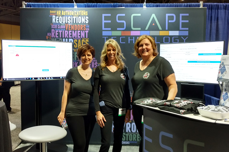 Arin, JenE and Terri show off the new booth