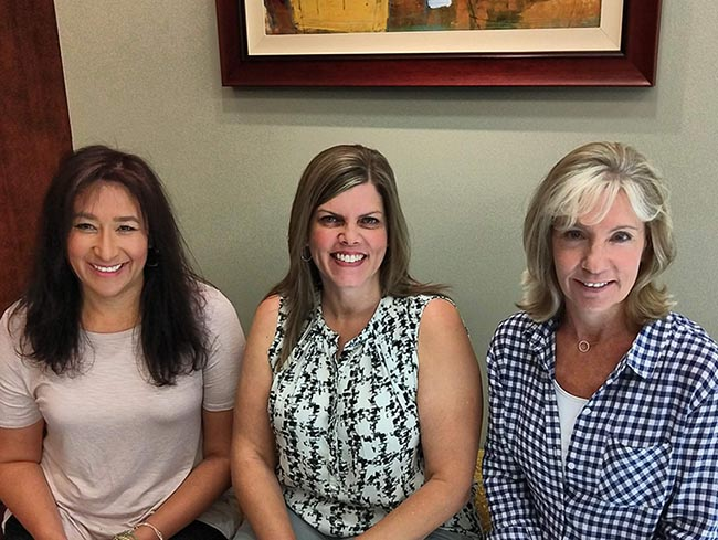 Pictured from left to right: Kathleen Bouillon, Executive Assistant; Stephanie Fury, HRA/Custom, Release/Testing Manager; and Ramona Marshall, President.