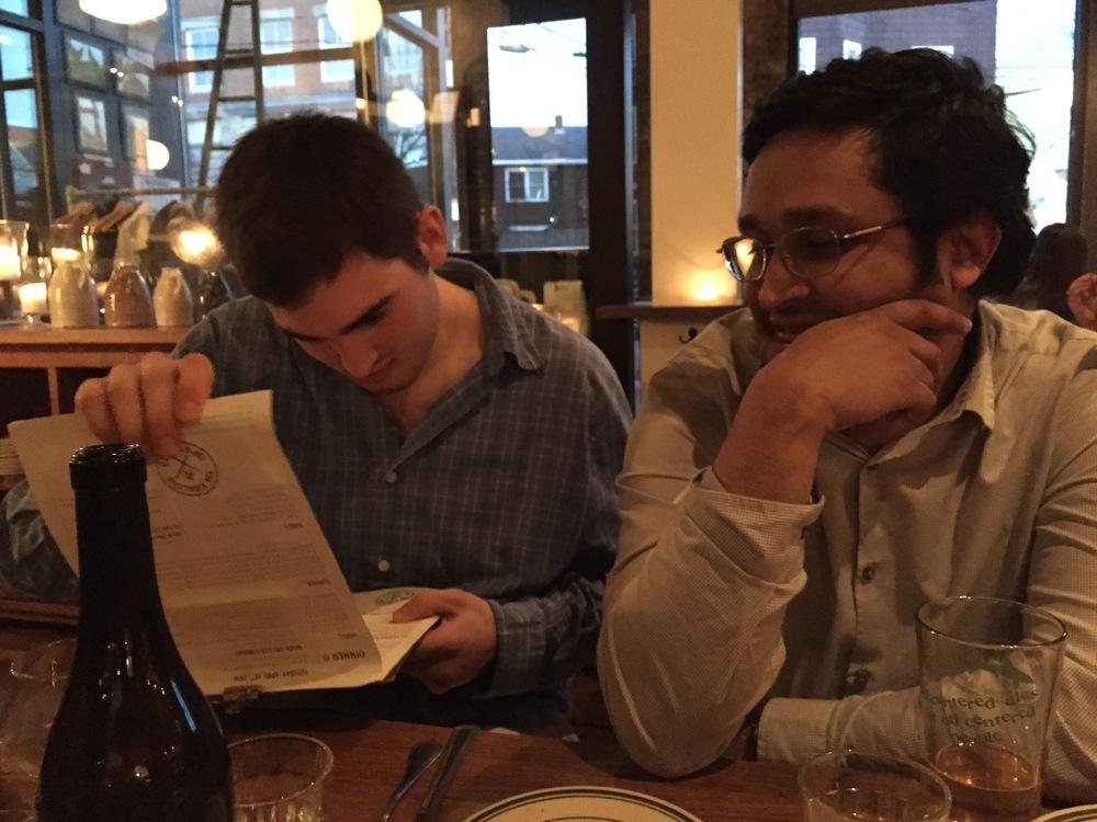 Derrick and Vardhan ponder then menu.