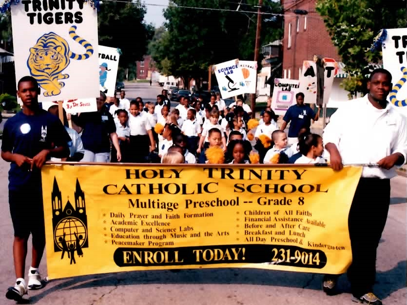 Most Holy Trinity Students marching in a parade that was part of the parish picnic