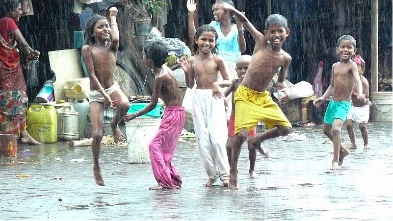Indian children dancing in the rain