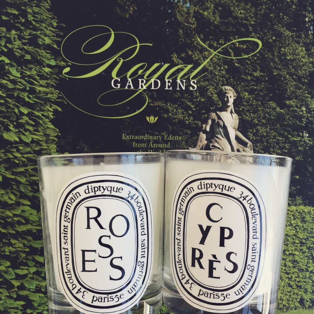 Diptyque candles, $60.00;  Royal Gardens  by Stephane Bern, available at The MET, $60.00