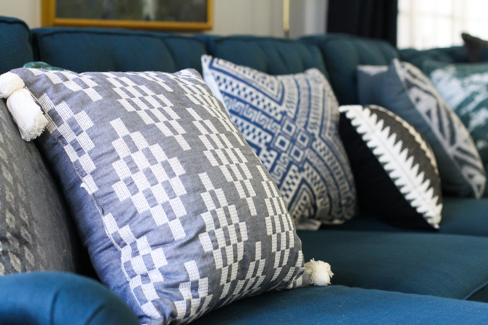 Blue Traditional Family Room with Layered Patterened Pillows