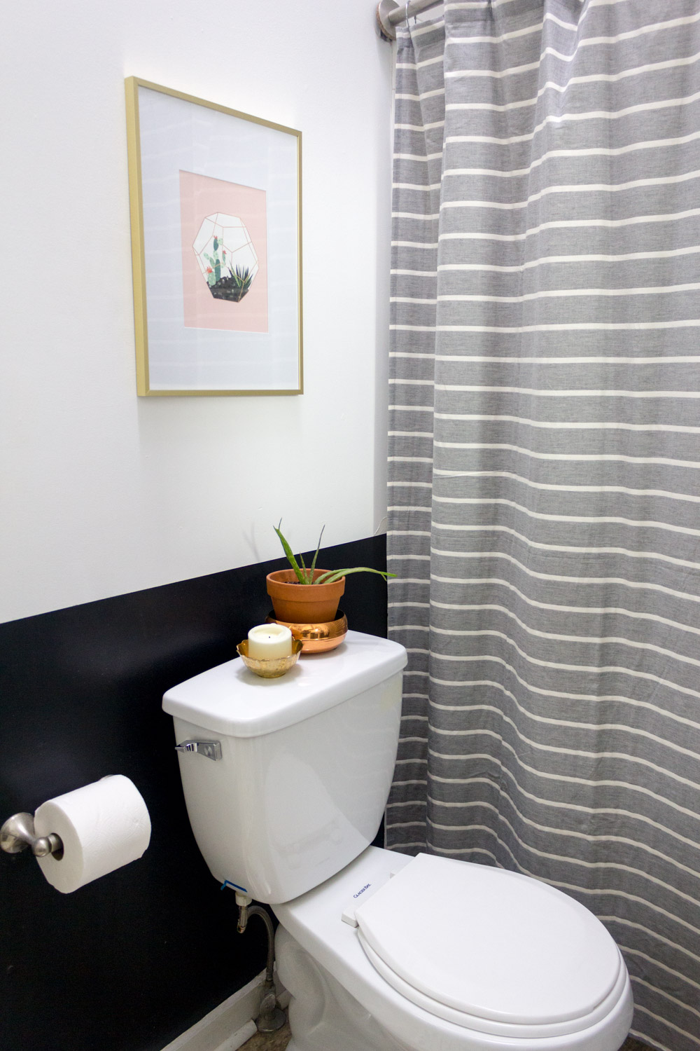 Pink terrarium print in black and white bathroom
