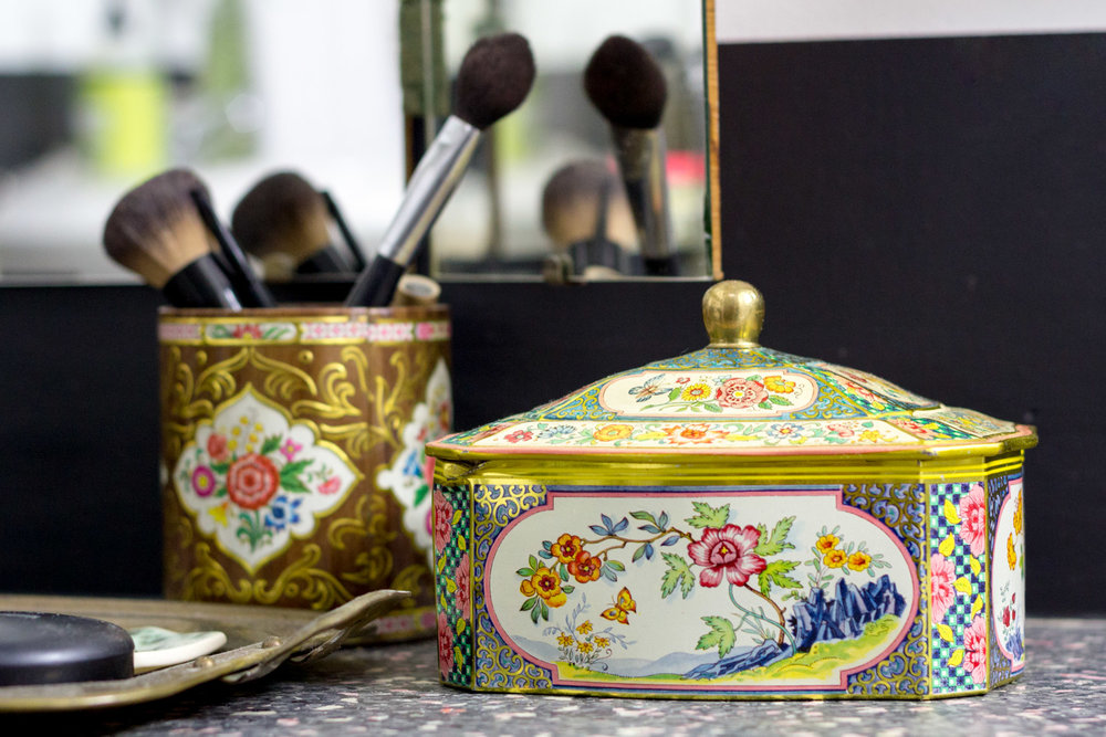 Makeup brushes in vintage tins