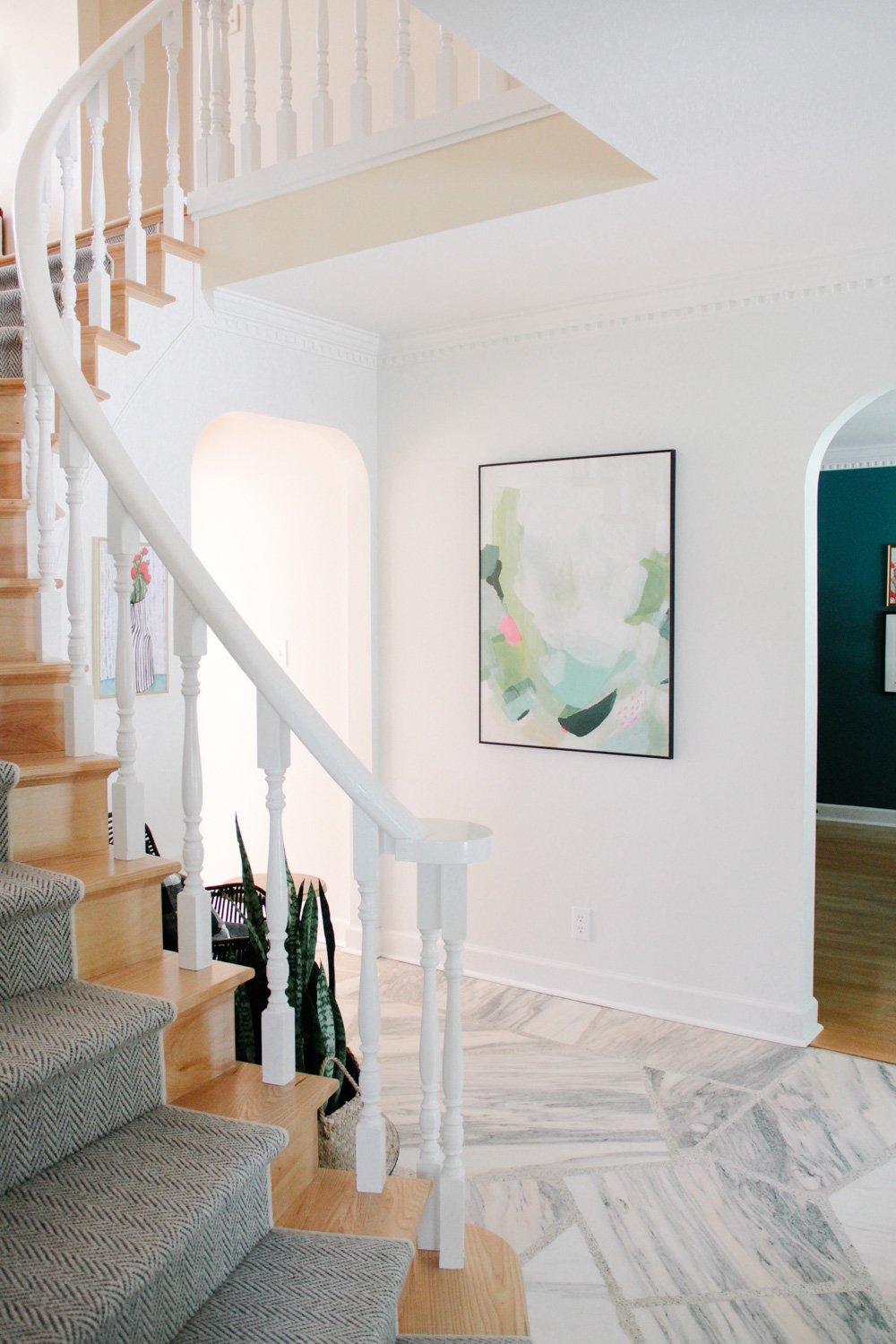 Modern Colonial Entryway with Herringbone Runner and Abstract Art