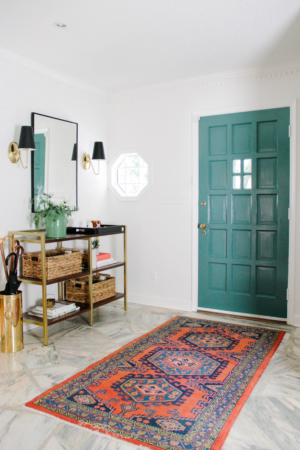 Modern Colonial Entryway with Colorful Antique Rug and Green Front Door