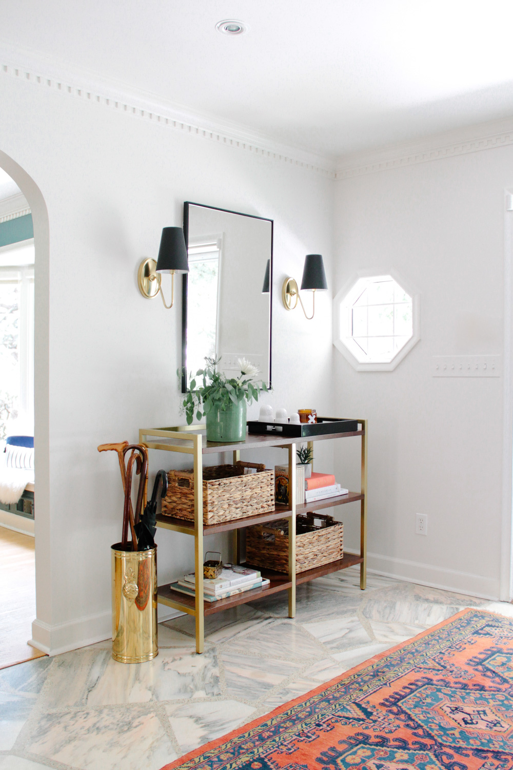 Modern Colonial Entryway with Colorful Antique Rug and Sconces with Black Shades