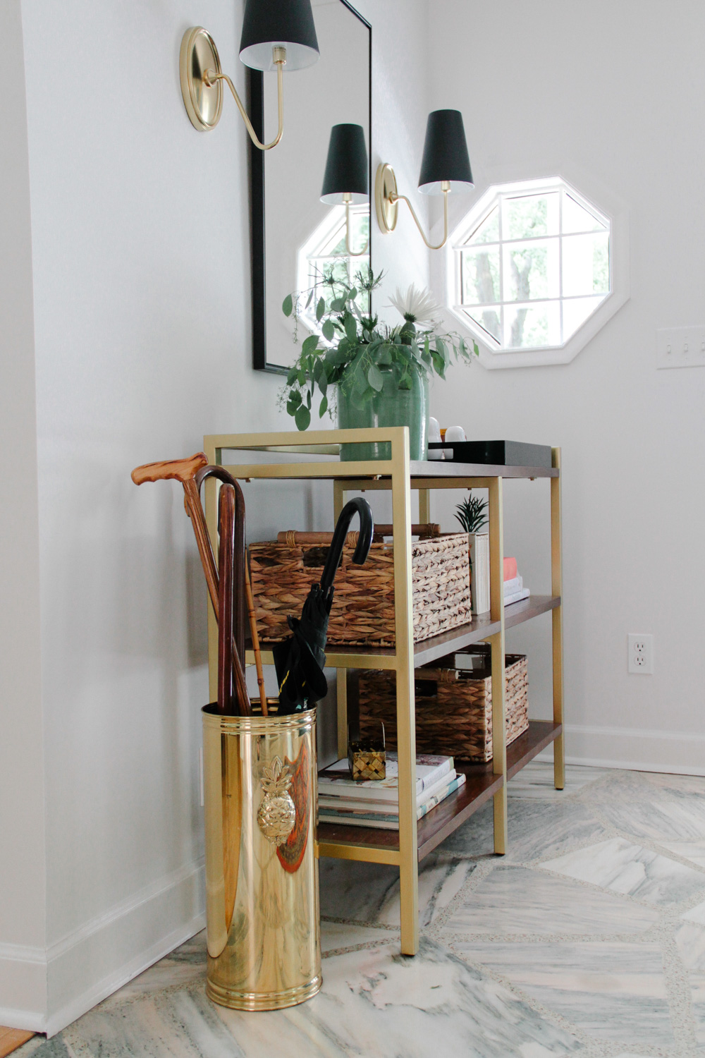 Modern Colonial Entryway with Marble Floors and Brass Umbrella Stand