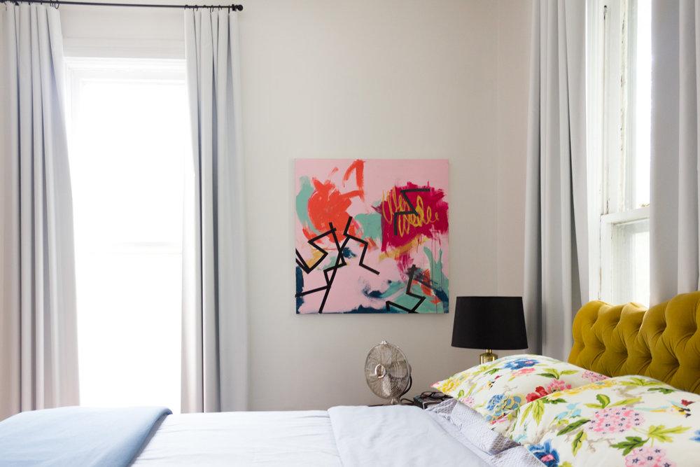 Hollywood Regency Bedroom with Gold Velvet Headboard