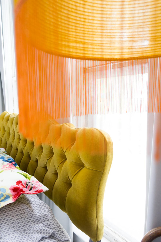 Gold Velvet Headboard and Hanging Fringed Lantern