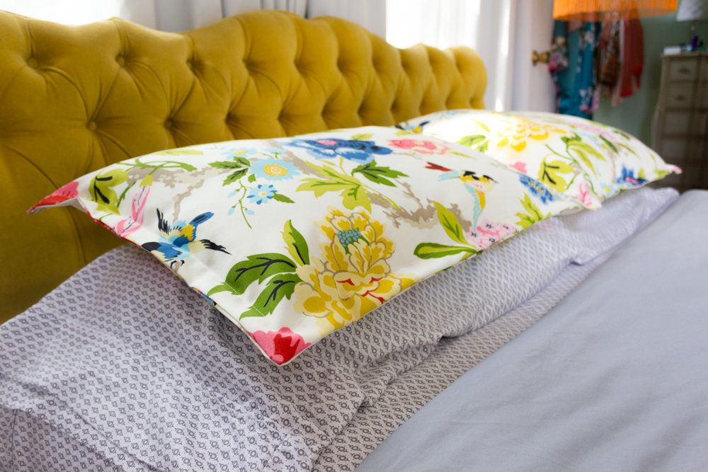 Colorful Floral Pillow Shams and Gold Velvet Headboard