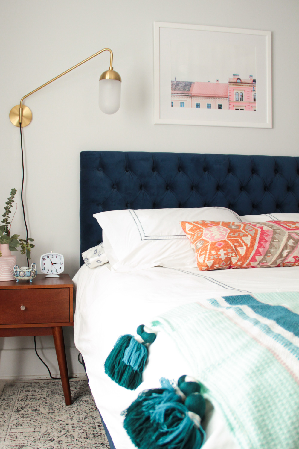 Bohemian and Luxe Master Bedroom with Blue Tufted Headboard