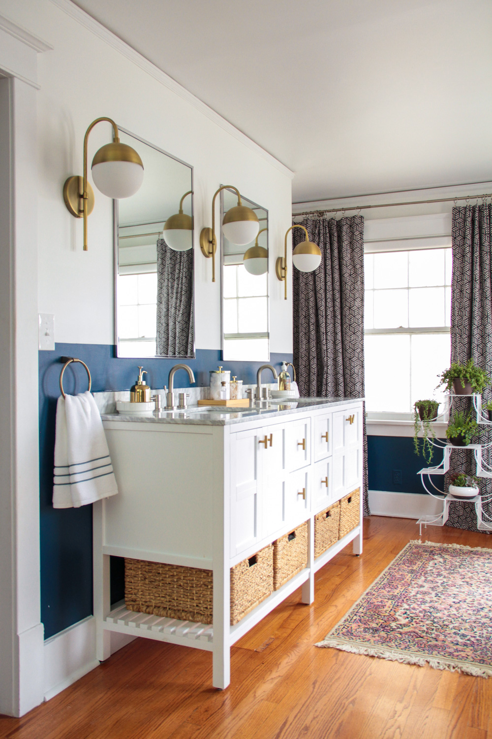 Blue and White Master Bathroom with Brass Sconces