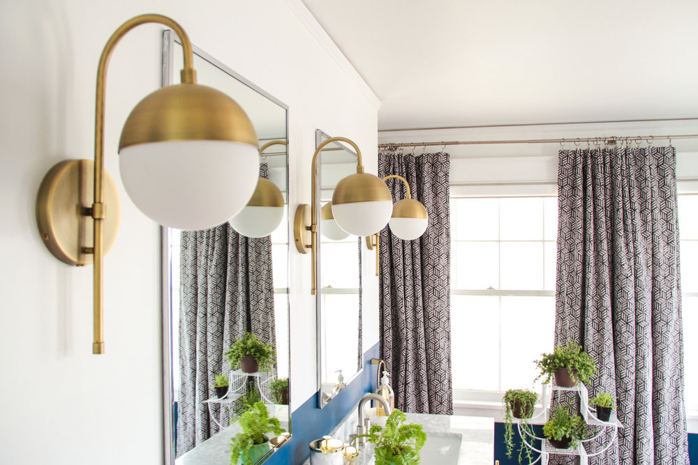 Brass Sconces in Bohemian Master Bathroom
