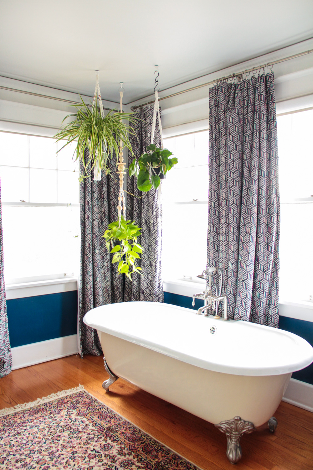 Bohemian Master Bathroom with Hanging Plants above Clawfoot Tub