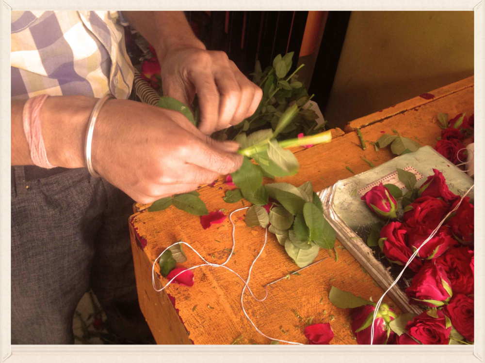 Making a rose garland, image©gunjanvirk.