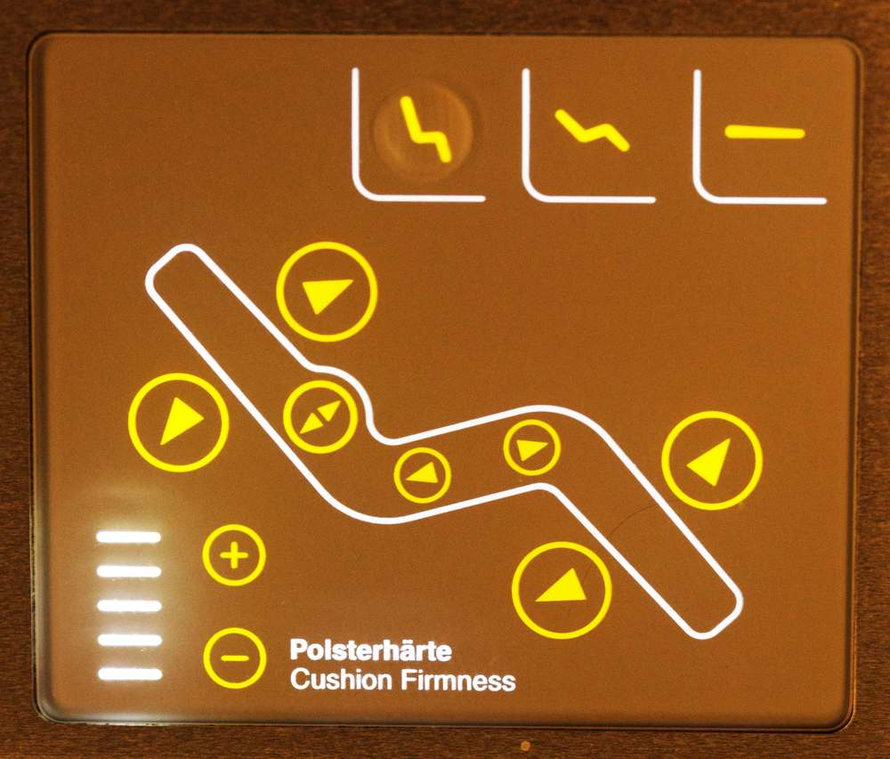 Image©sourcingstyle.com, Arm-rest monitor to control seat firmness in Lufthansa Business Class A380.