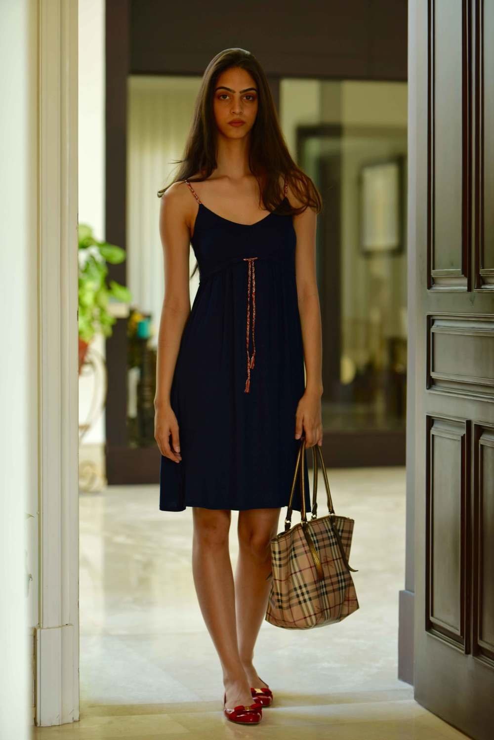 My friend Mannat in a Zara dress, Burberry tote and Ferragamo ballet flats. Image©gunjanvirk