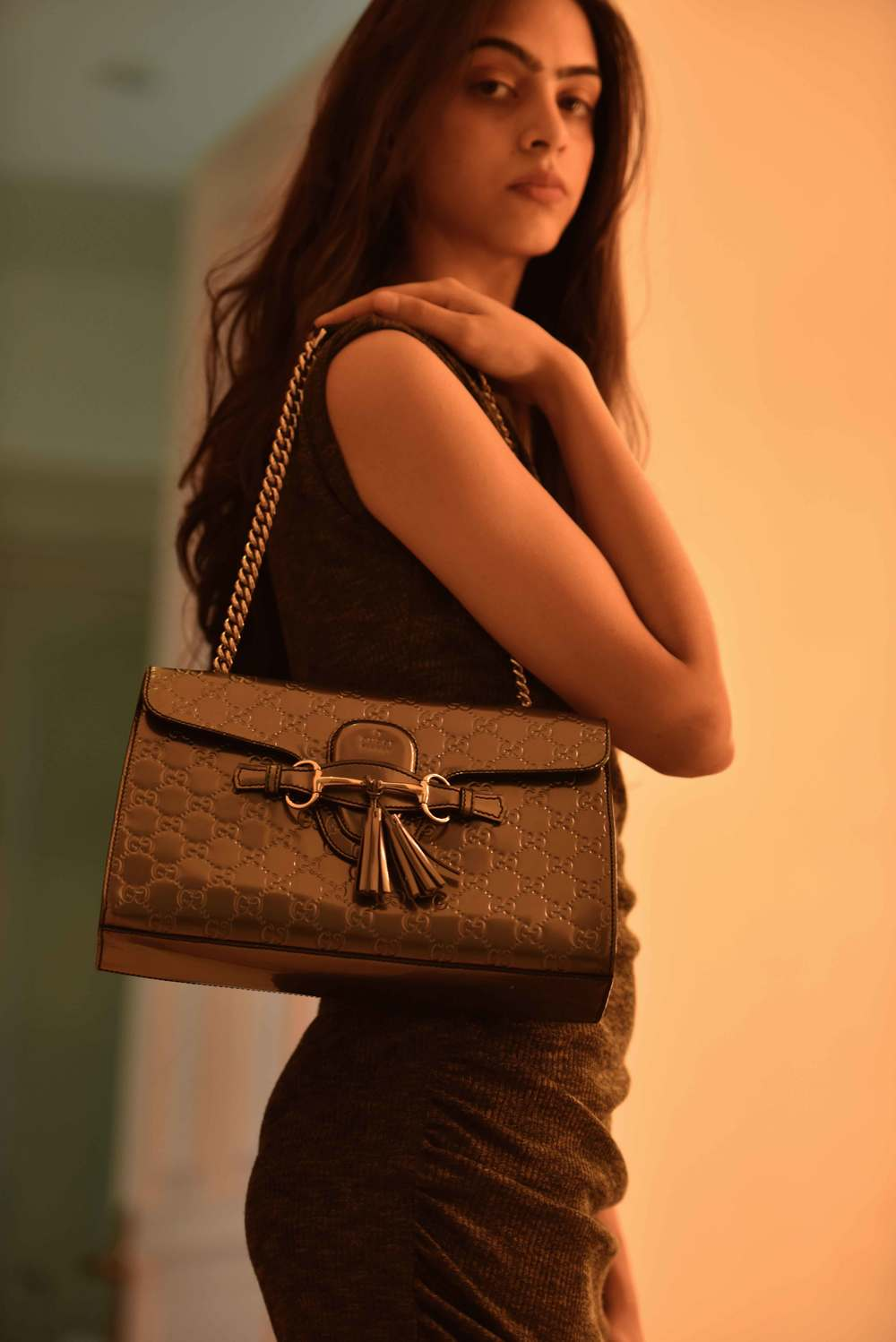 An evening wear look: a basic sheath dress with a Gucci evening bag. Model: Mannat Dhaliwal, Image©sourcingstyle.com