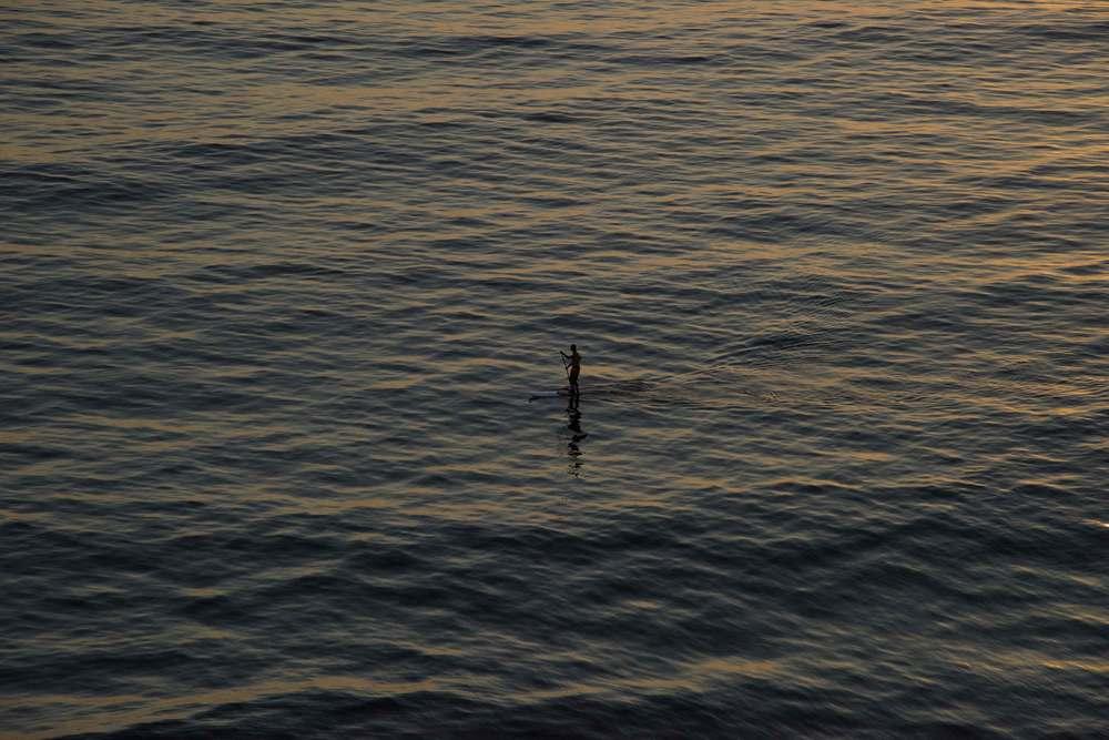 A lone surfer at Swamis beach, Encinitas, CA. Image©gunjanvirk