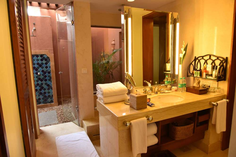Luxurious restroom in my room at the Park Hyatt Hotel, Goa with an outside shower, image©sourcingstyle.com