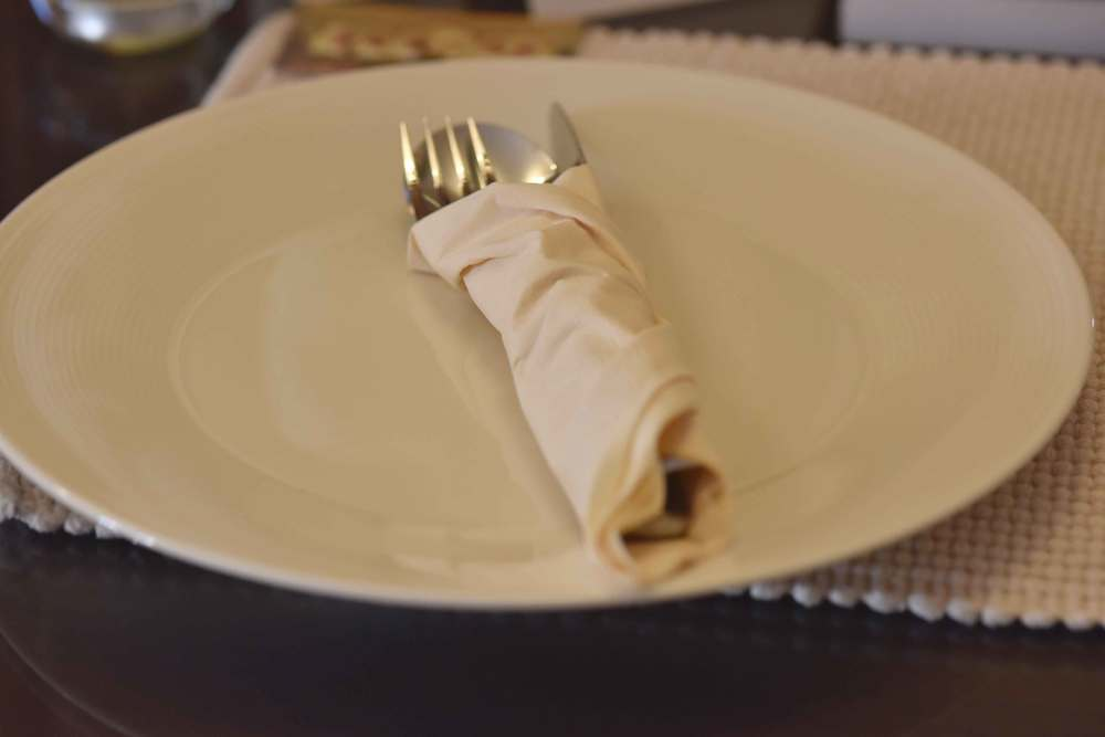 An empty plate with knife, fork and spoon. Image©gunjanvirk