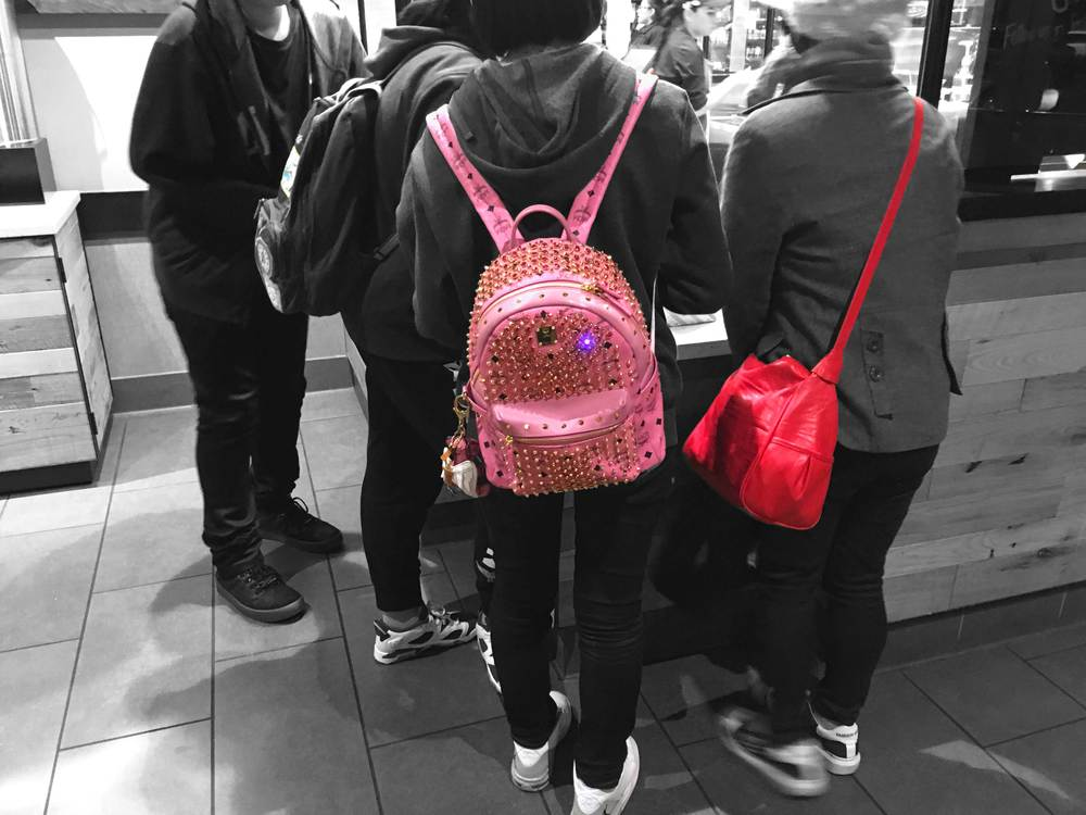 Trendspotting-bright and colorful bags!! I love your bags! At Starbucks ordering my hot chocolate with cream....so delicious! Citadel Outlets, LA, CA, USA. Image©gunjanvirk