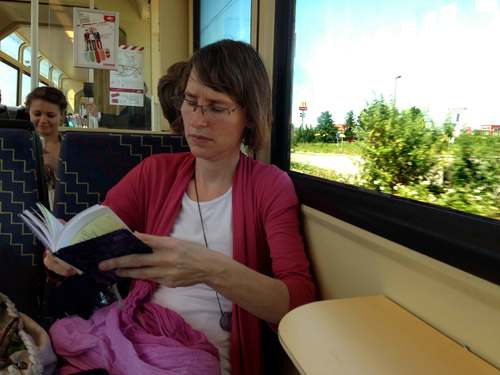 My friend Nicola catches up on her reading in the train! Image©gunjanvirk