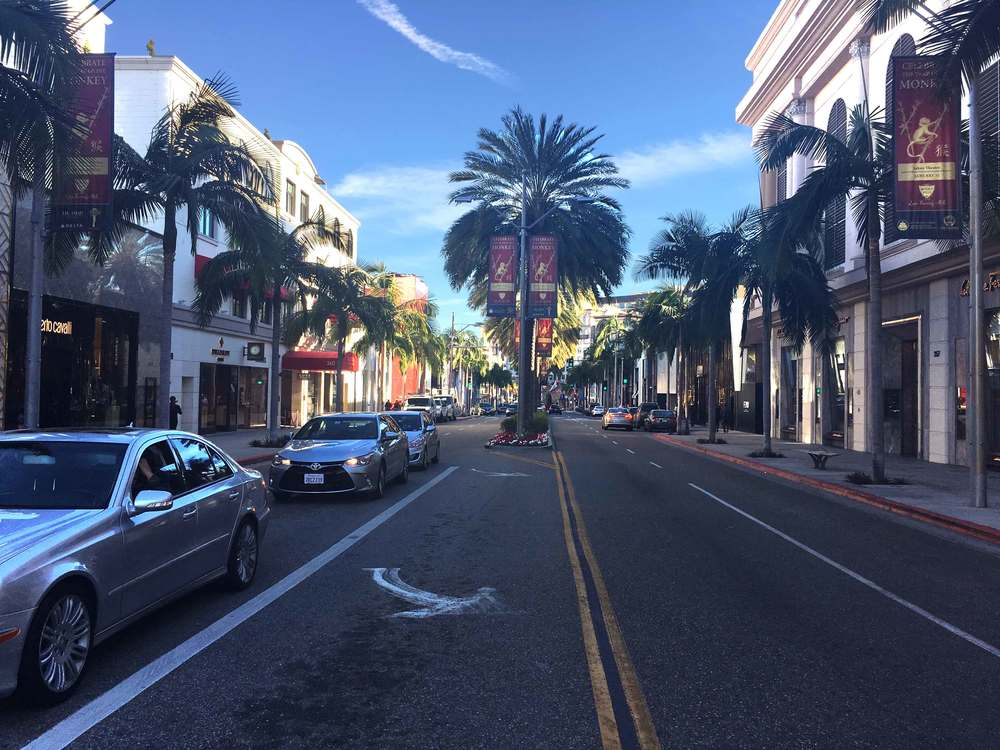 Rodeo Drive, Beverly Hills lined with palm trees. Rodeo Drive, Beverly Hills, L.A. Image©gunjanvirk