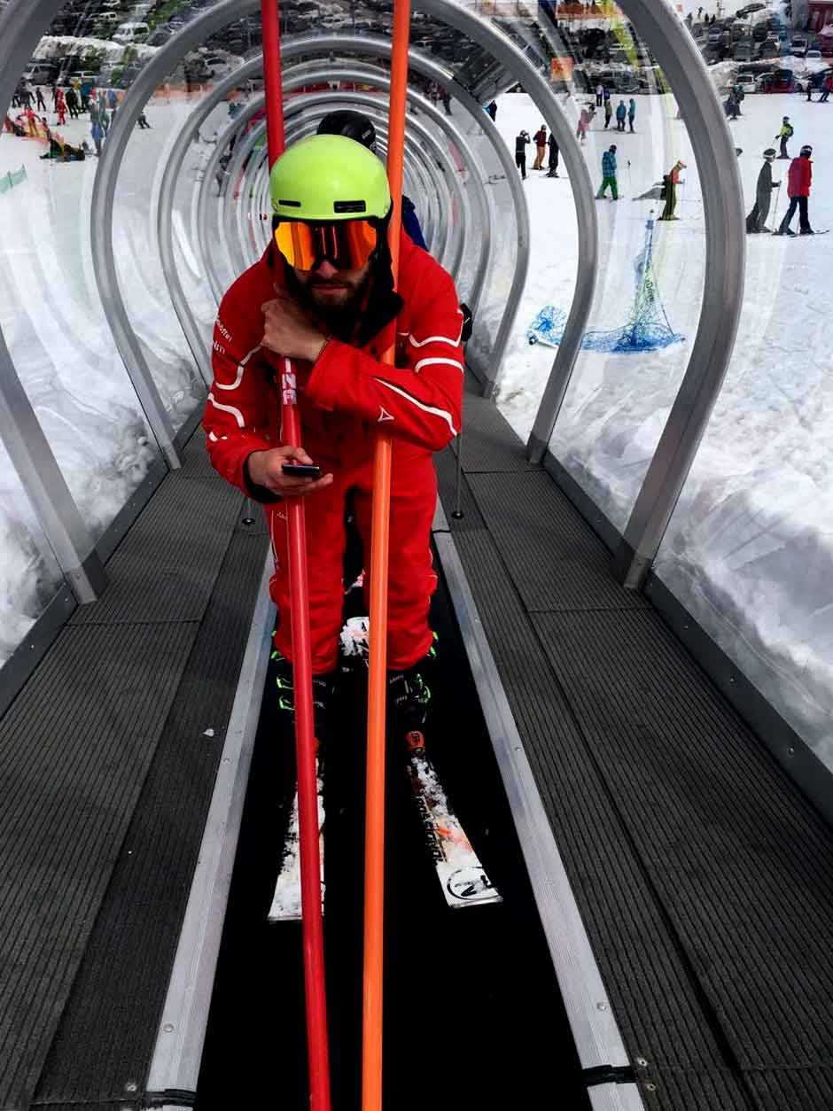 Ski Instructor going up the tunnel to ski. Image©gunjanvirk