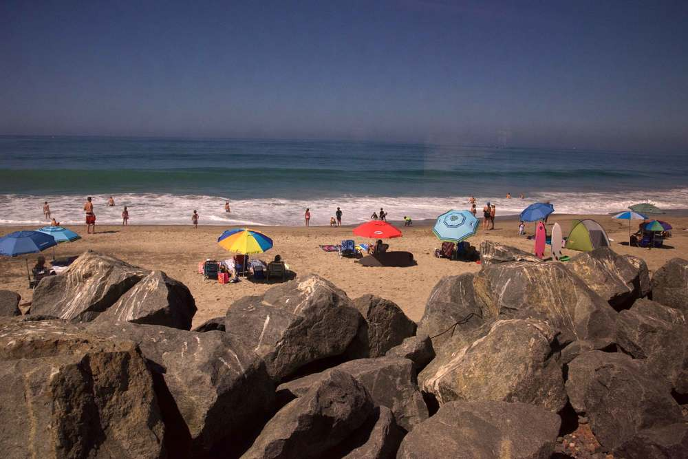 Sunbathing on the beach, swimming in the ocean, people enjoying a sunny day at the beach. Encinitas to L.A. by train. Image©gunjanvirk