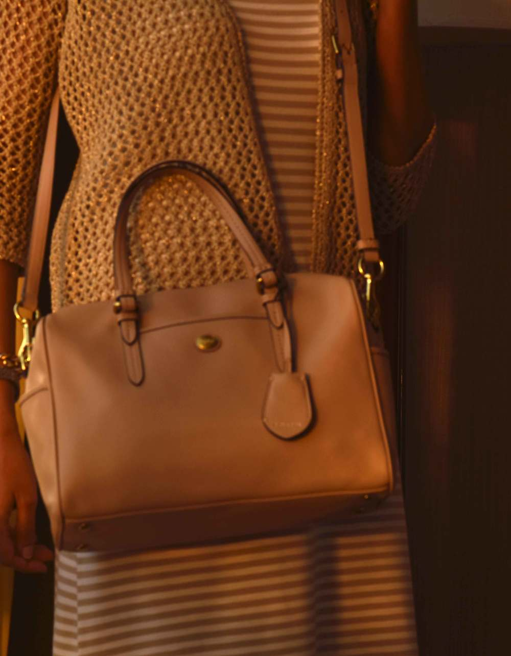 My Chicos striped summer dress, a Chicos bolero jacket, a neutral color Coach bag. Image©sourcingstyle.com
