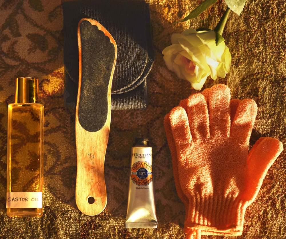 Castor oil, Earth Therapeutics wooden foot file, cotton socks, L'Occitane dry skin foot cream, Body Shop scrub gloves. Image©sourcingstyle.com