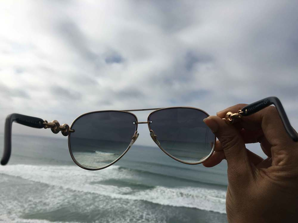 Seeing the world through my Gucci shades, ocean view, stormy day at the ocean, Swamis beach, Encinitas, California. Image©sourcingstyle.com
