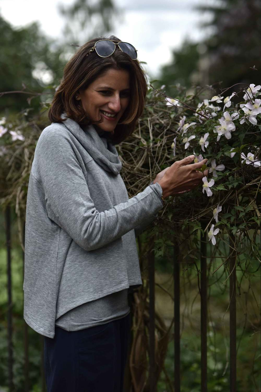 Happy with flowers. Eileen Fisher Funnel Neck Drapey Tencel Terry Cropped Top in Moon. Image©sourcingstyle.com, Photo: Nicola Nolting