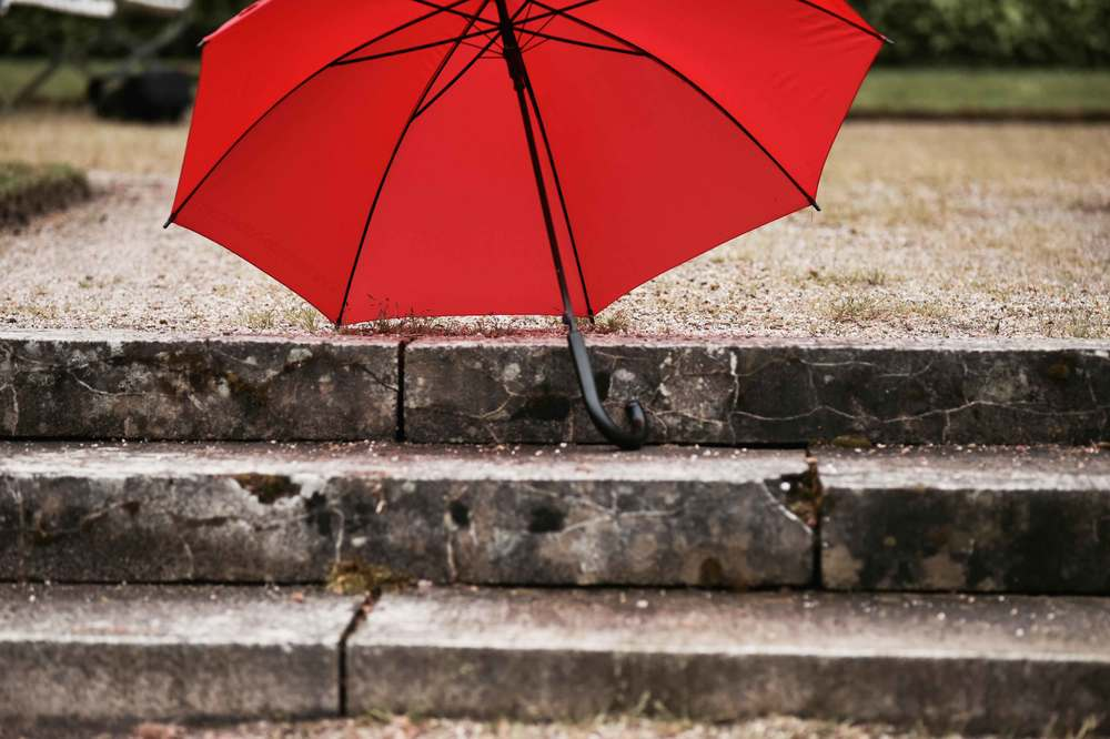 A red umbrella, Gönneranlage, historic park, Baden Baden, Germany. Image©sourcingstyle.com