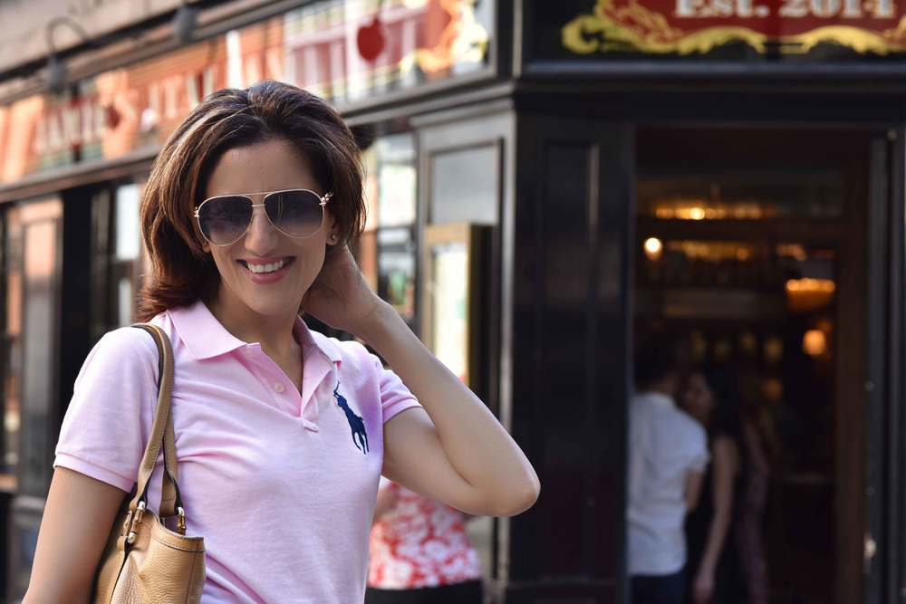 Ralph Lauren skinny polo tee, in front of Jamie's Kitchen, London. Image©sourcingstyle.com