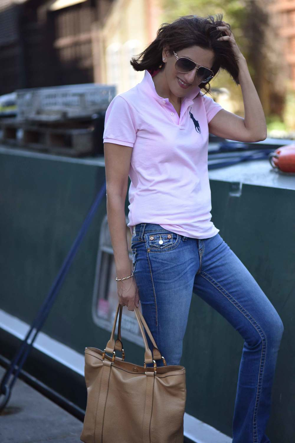 Ralph Lauren skinny polo tee, True Religion jeans, Gucci tote bag, London. Image©sourcingstyle.com