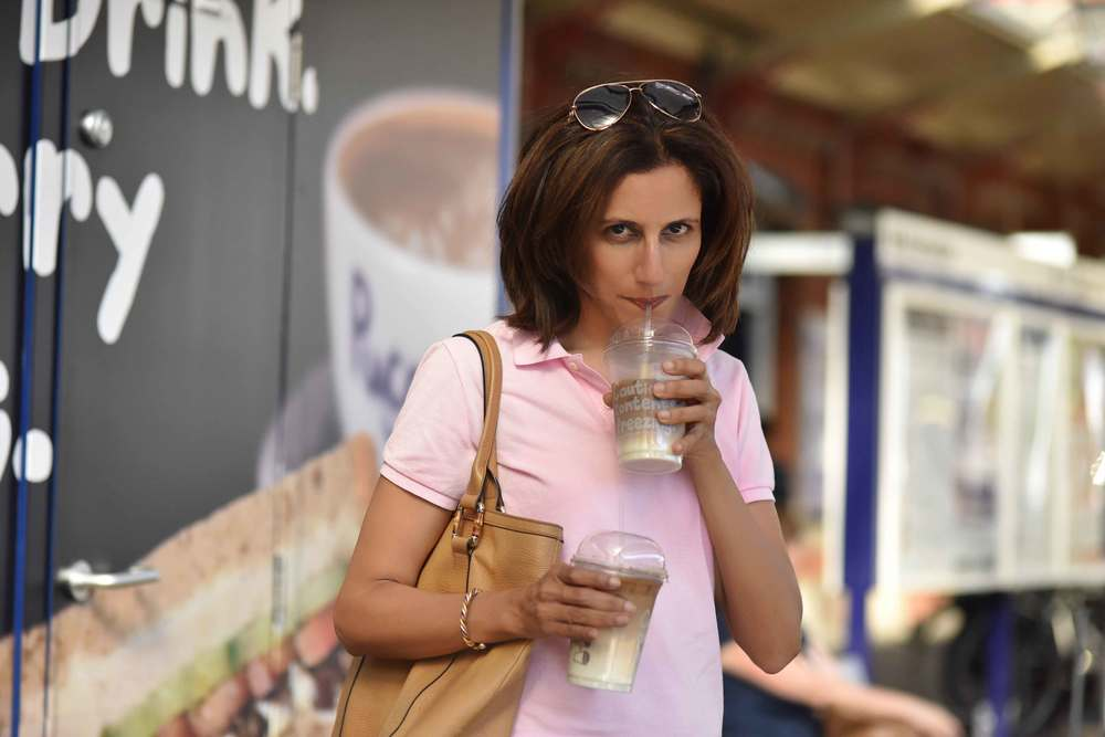 Sipping iced latte, London underground, Image©sourcingstyle.com