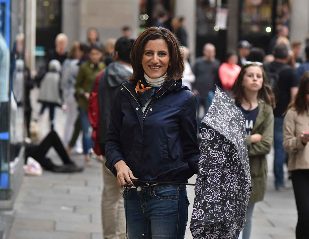 Zara water repellent jacket, Zara printed pocket square, Zara bandana print umbrella, True Religion jeans, Ralph Lauren polo sweater, Covent Garden, London, UK. Image©sourcingstyle.com
