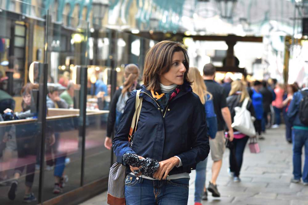 Zara water repellent jacket, Zara printed pocket square, Zara bandana print umbrella, True Religion jeans, Ralph Lauren polo sweater, Apple Market, Covent Garden, London, UK. Image©sourcingstyle.com