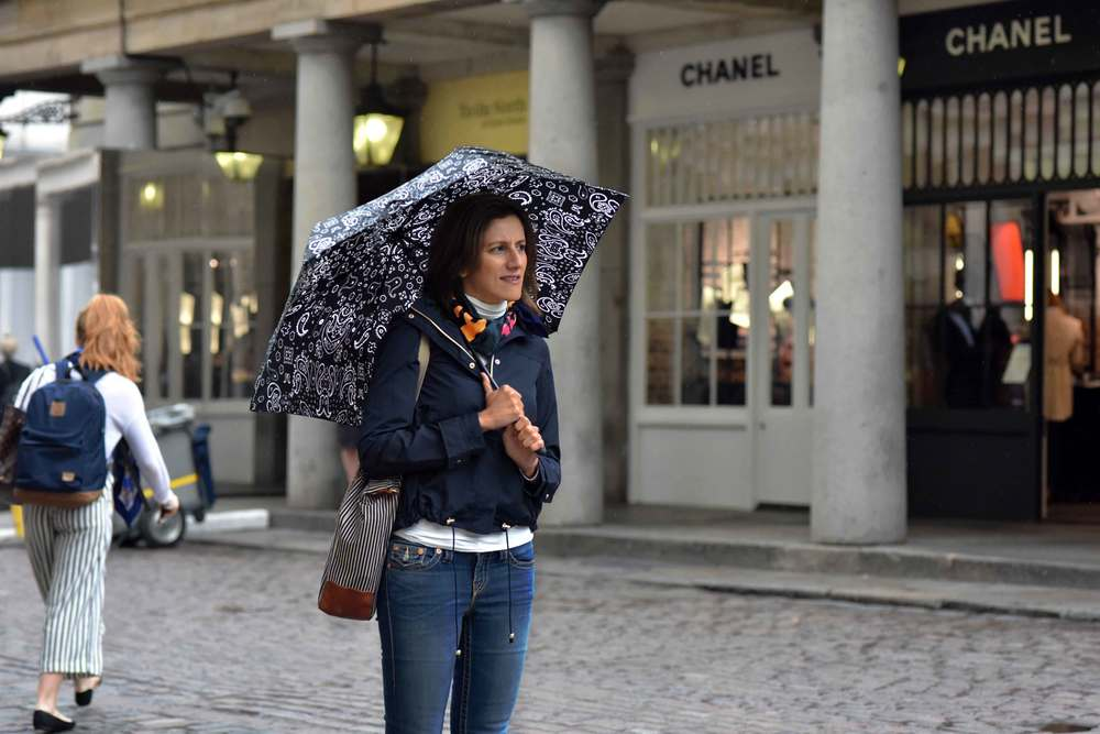 Zara water repellent jacket, Ralph Lauren polo sweater, Zara printed pocket square, Zara bandana print umbrella, True Religion jeans, Covent Garden, London, UK. Image©sourcingstyle.com