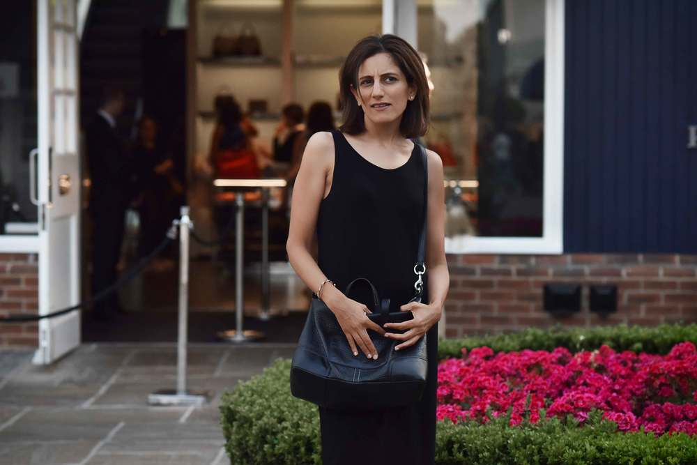Eileen Fisher jersey black tank dress, Coach crossbody bag, Bicester Village. Image©sourcingstyle.com
