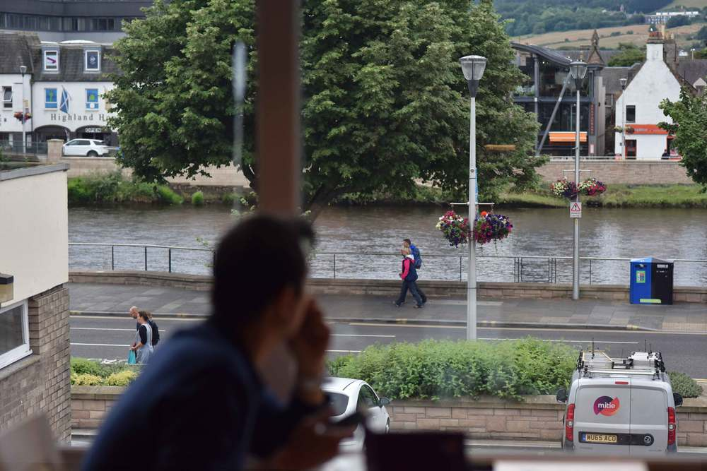 City of Inverness, view from a table, breakfast buffet, Mercure hotel, Inverness, Scotland. Image©sourcingstyle.com